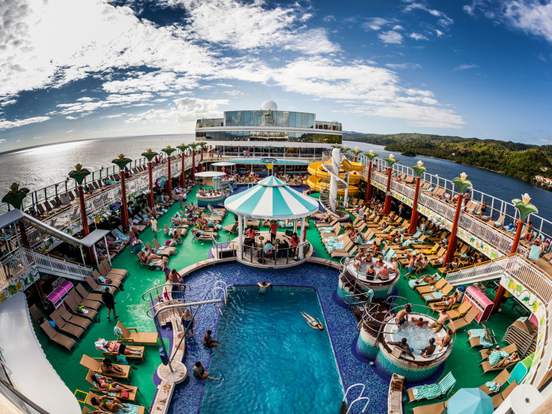 View of a cruise ship pool and deck from above.