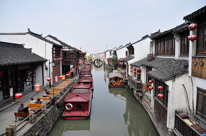 Boats in a canal in Suzhou, China