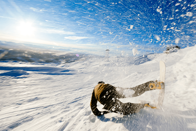 This is a picture of a man snowboarding.