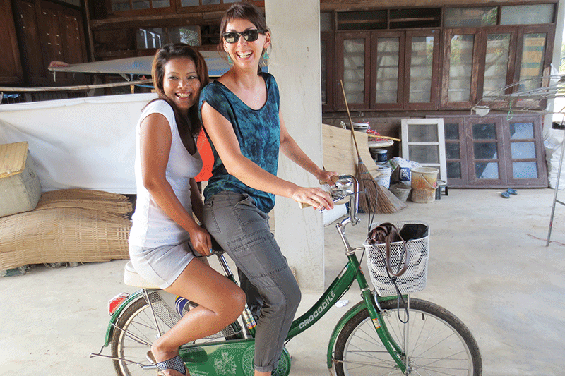The writer sharing a bicycle with a friend in Chiang Mai, Thailand.