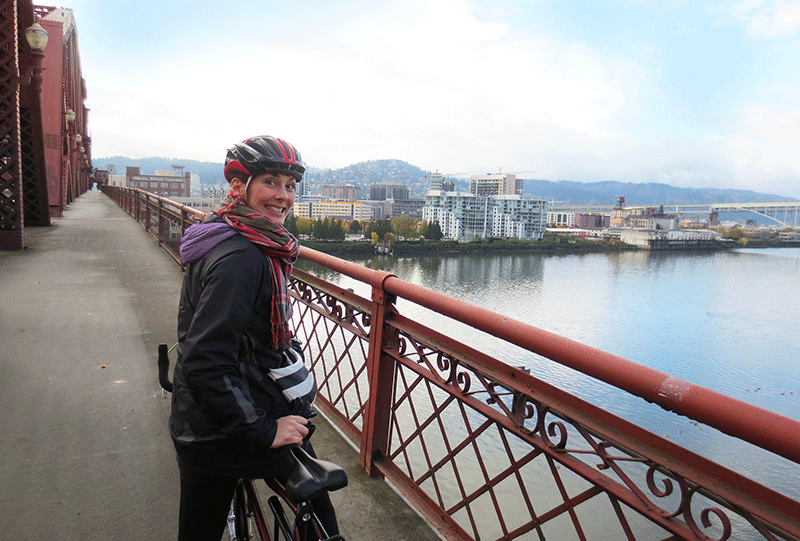 The author on a bike at Willamette Bridge in Portland, Oregon.