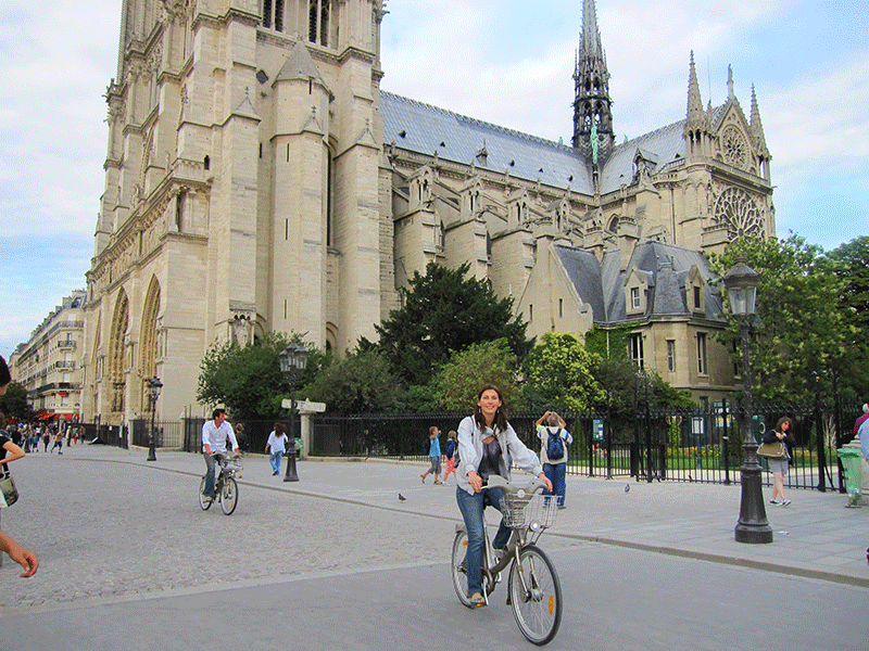The author riding a bicycle in Paris, France.