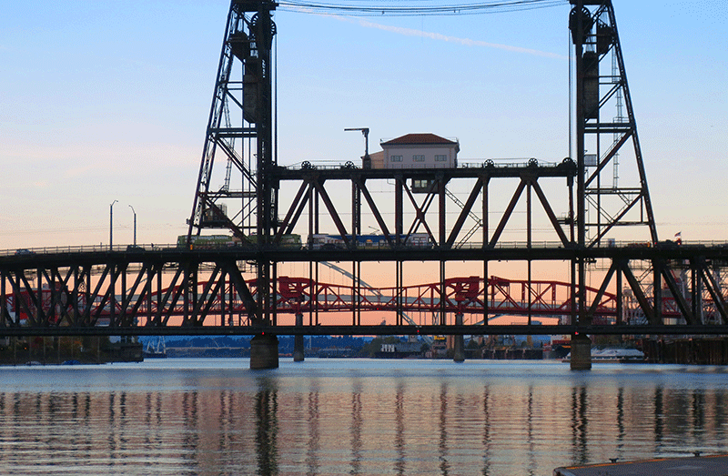 Pedestrian's view of the sunset over the Willamette River in Portland, Oregon.