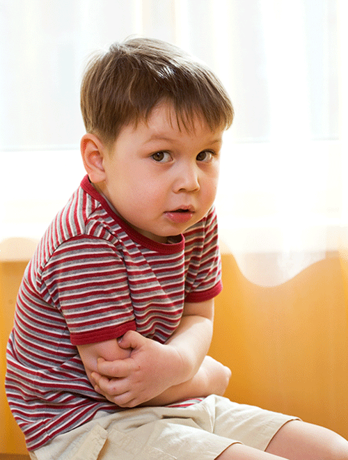 sick child holding tummy during vacation