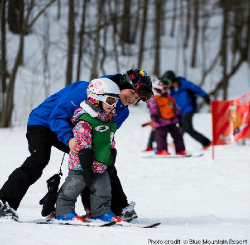Mother and child playing in snow at Blue Mountain Village Resort, Ontario