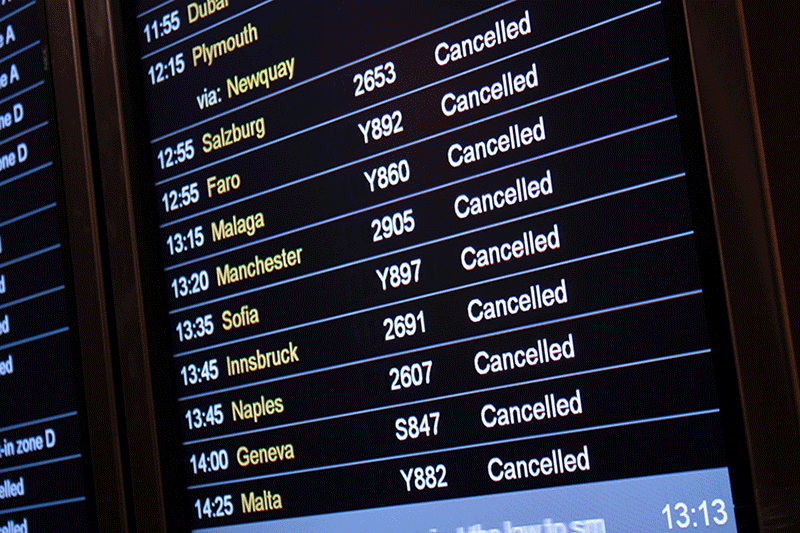 Cancelled flights board at the airport. Travel Insurance can help you to deal with this issue.