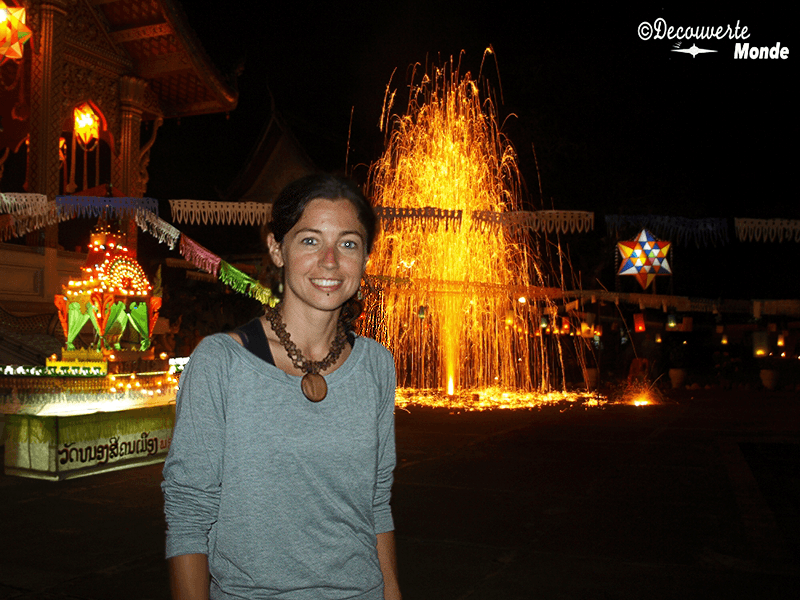 Girl in the foreground at night at the Festival of Lights in Luang Prabang, Laos