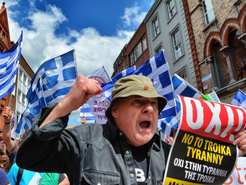 Man in Greece Protesting: Travel Advice for Greece