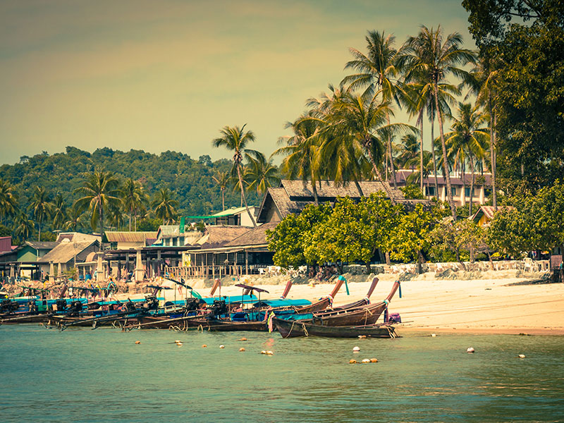 Long-tail boats at beach in Krabi, Thailand.