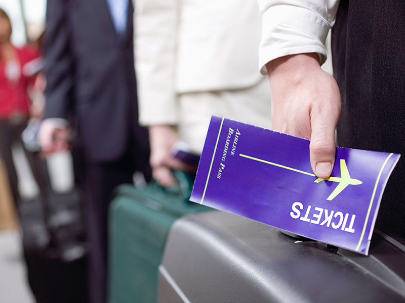 Man holding a brief case and boarding pass