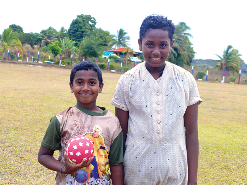 This is a photo of a boy and girl student taken while volunteering in WavuWavu, Fiji.