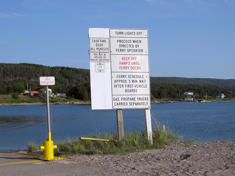 Sign showing instructions for users of the ingonish ferry: turn lights off, keep off ramps.