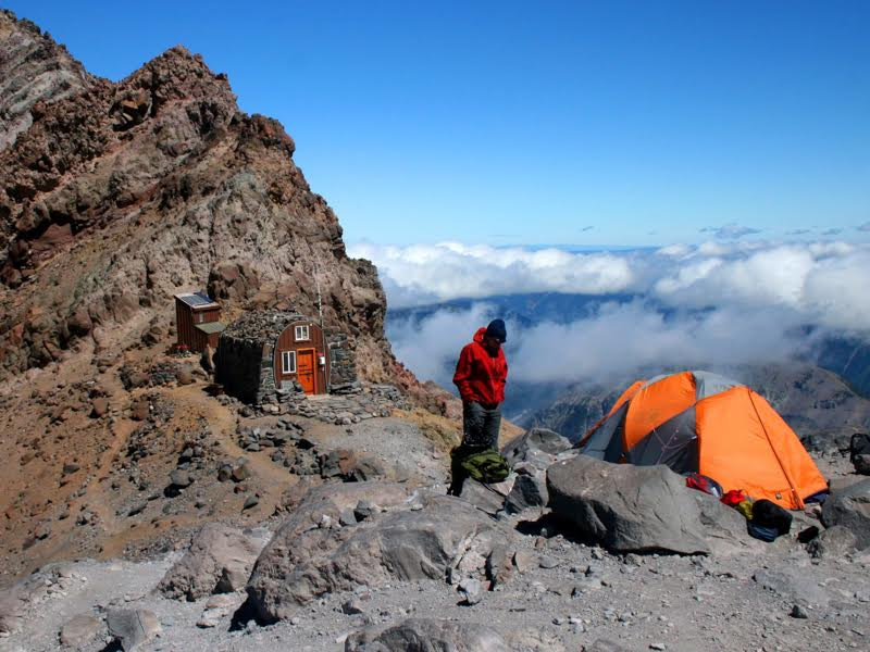 high altitude trekker camping a mountain hut