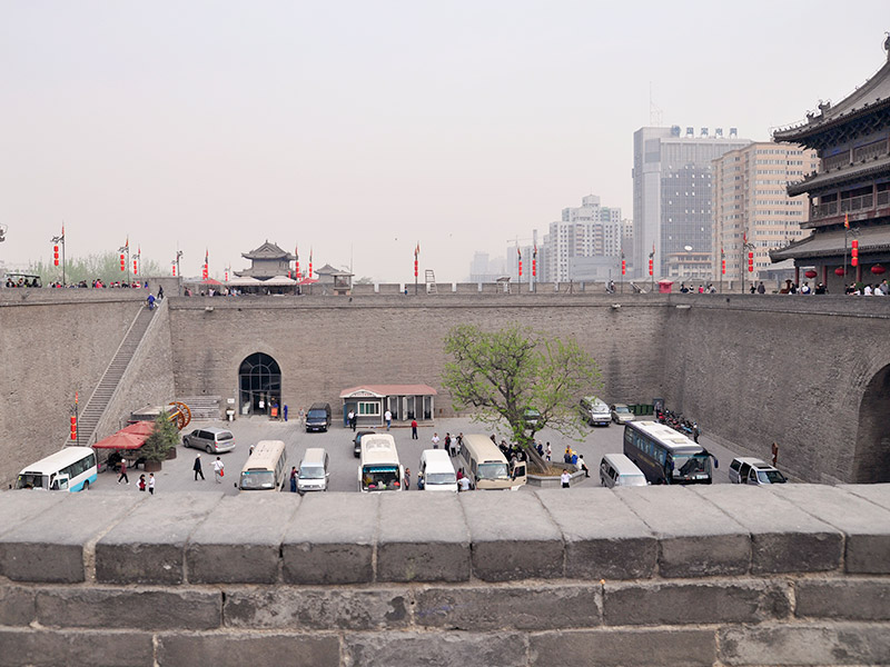 China's soldiers would be stationed on walls to defend their cities, using weapons like catapults and bows and arrows.
