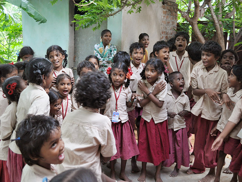 Children singing and dancing in Thirukalikundram, India