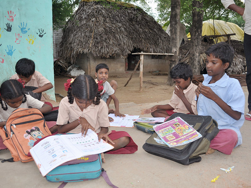 Children doing homework in Nallan Pillai Petral, India