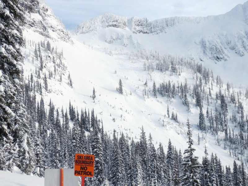 View of Whitewater Resort's sidecountry and ski patrol boundary signs, Nelson, BC. Photo credit: Stephen Lerch.