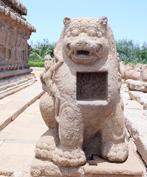see the Durga's lion statue while visiting the Shore Temple