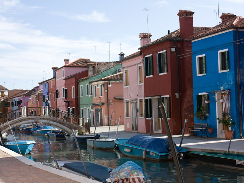 Burano presenting its bright coloured houses and its breathtaking sinuous canals