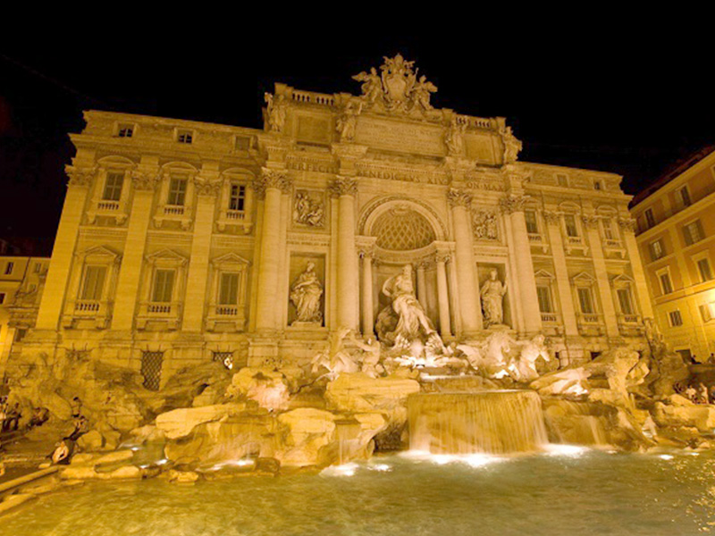 Make a wish and throw a coin in the Trevi Fountain in Rome