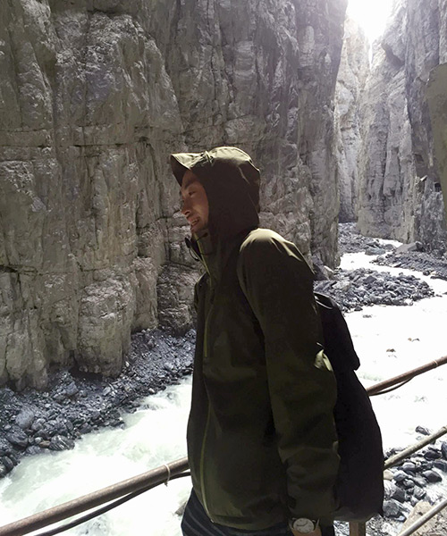 Traveller wrapped in warm clothes in the canyons of the glacier