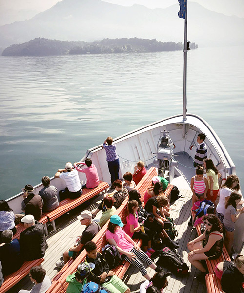 Passengers on the cruise, admiring the Swiss scenery