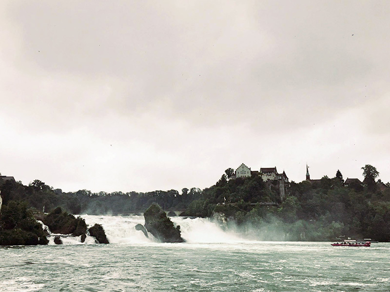 swiss tour boats approach rhine falls for closeup view