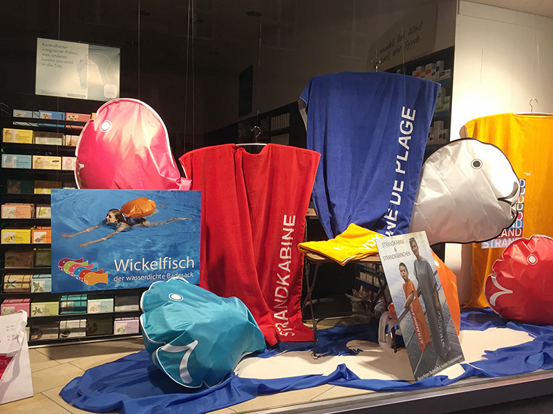 wickelfisch dry bags hold personal items while tourists swim in the rhine
