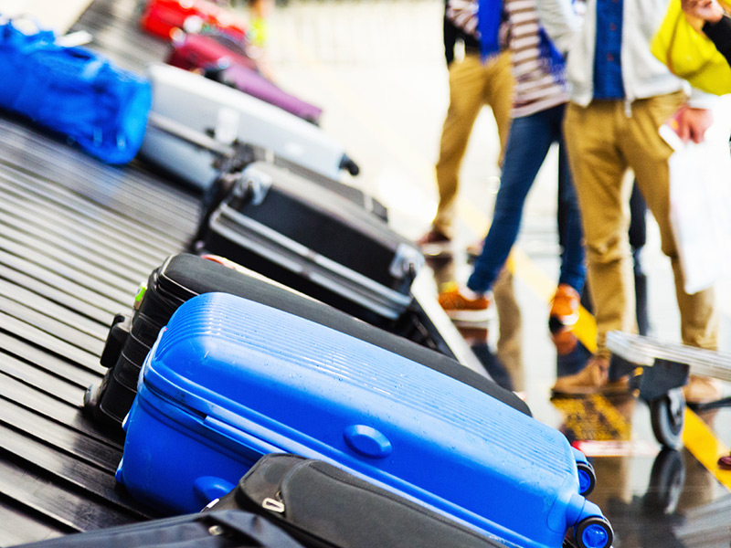 suitcases on a baggage carousel