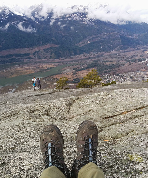 mountaintop view and hiking boots