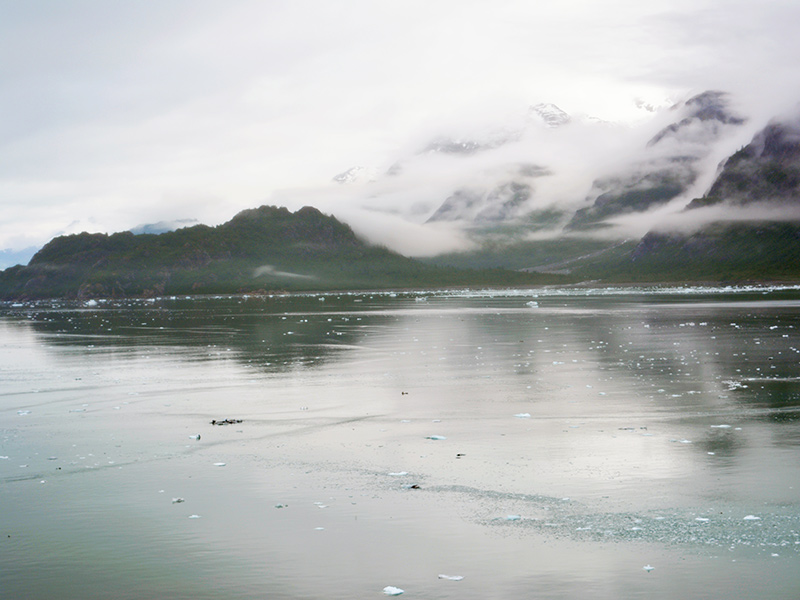 Cruise past mountains and glaciers in Alaska