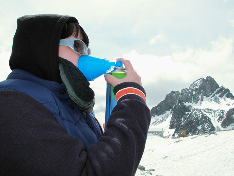 woman using mini oxygen cylinder