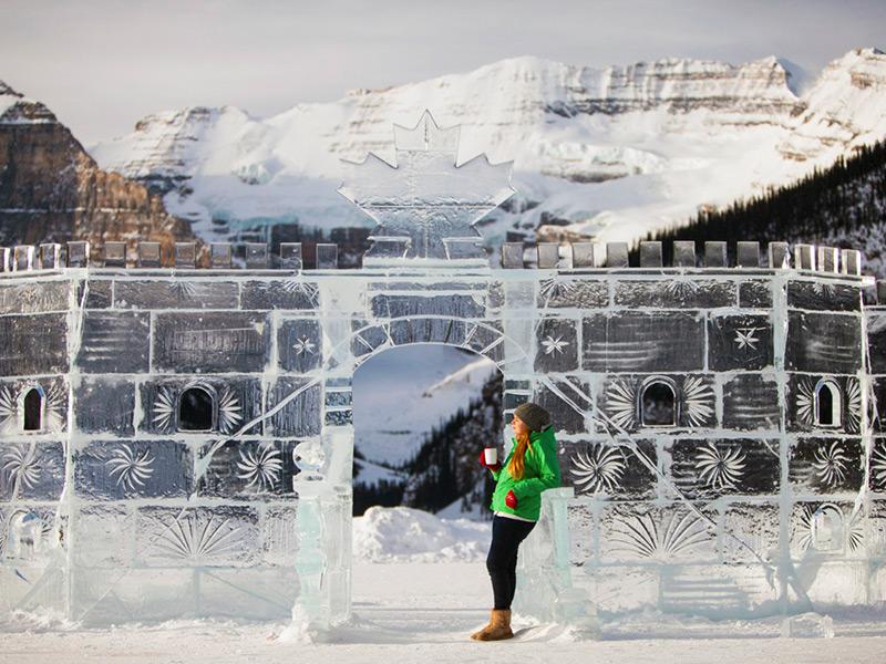 Woman admiring an ice sculpture in Banff