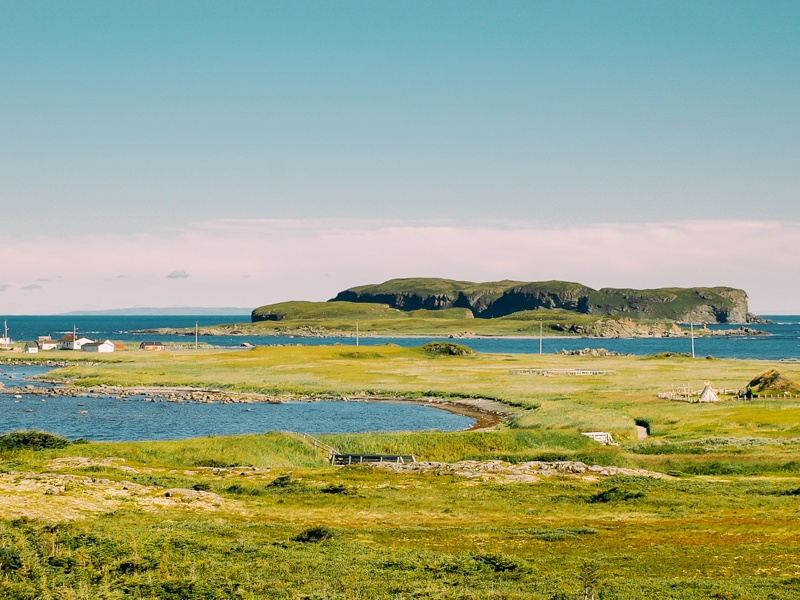 Photo of Newfoundland's Anse aux Meadows along the Atlantic Ocean, a top destination for travellers