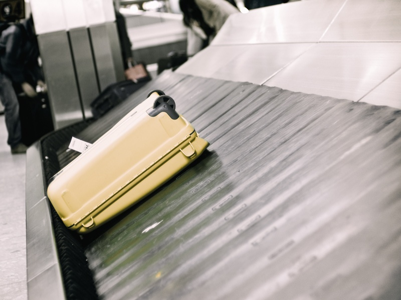 Suitcase on a baggage carousel waiting to be picked up by a traveller.