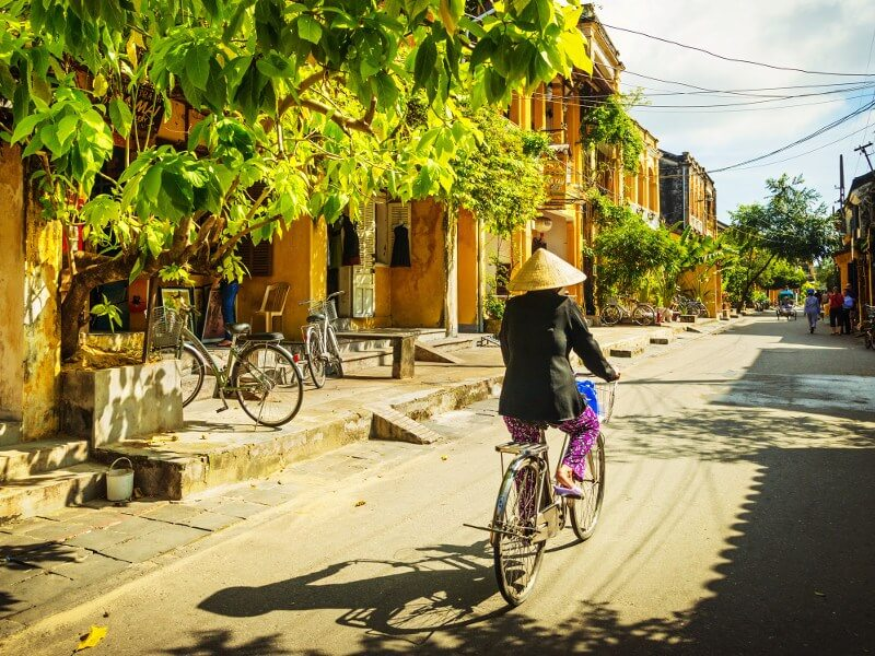 hoi an street Vietnamese woman bicycle