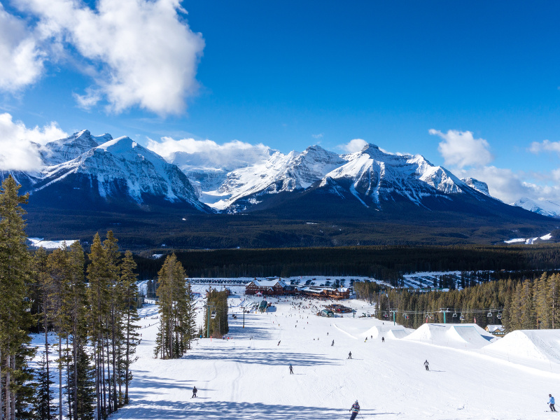 Skiers and snowboarders at lake louise ski resort