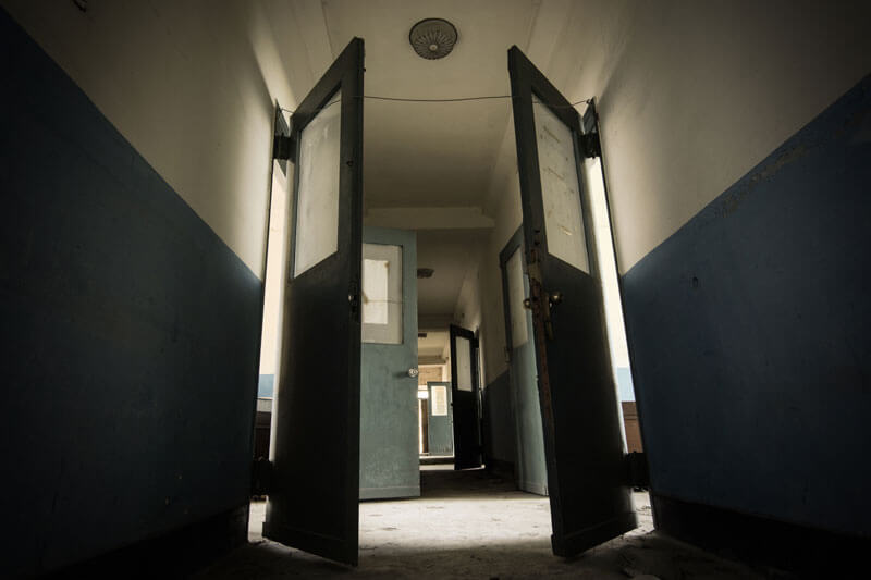 Hallways of a defunct sanitorium
