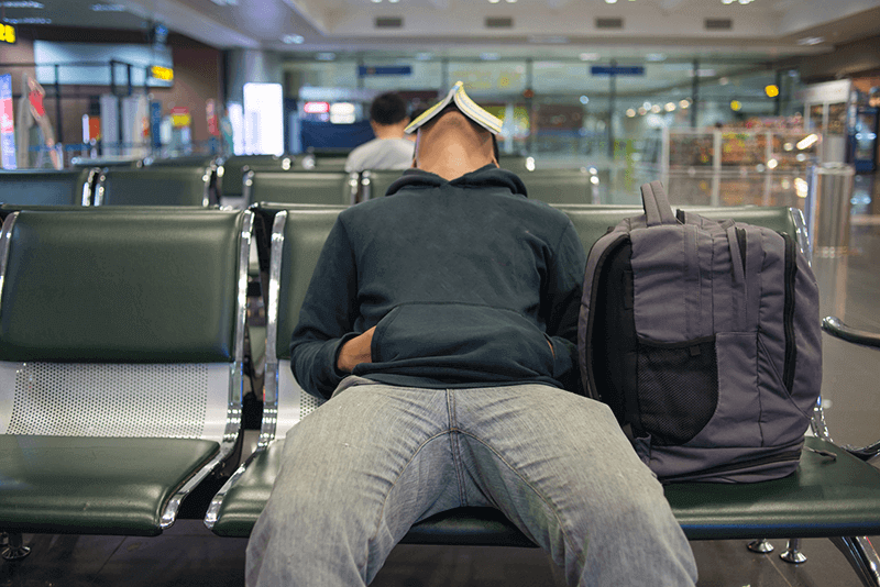 Person sleeps at airport after cancelled flight leaves them stranded