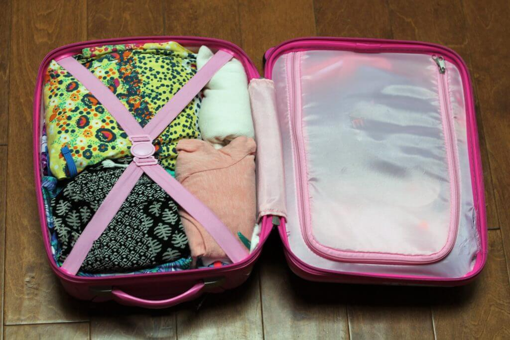 Make sure you utilize every compartment in your carry-on luggage. Rolling your clothes saves room, too!