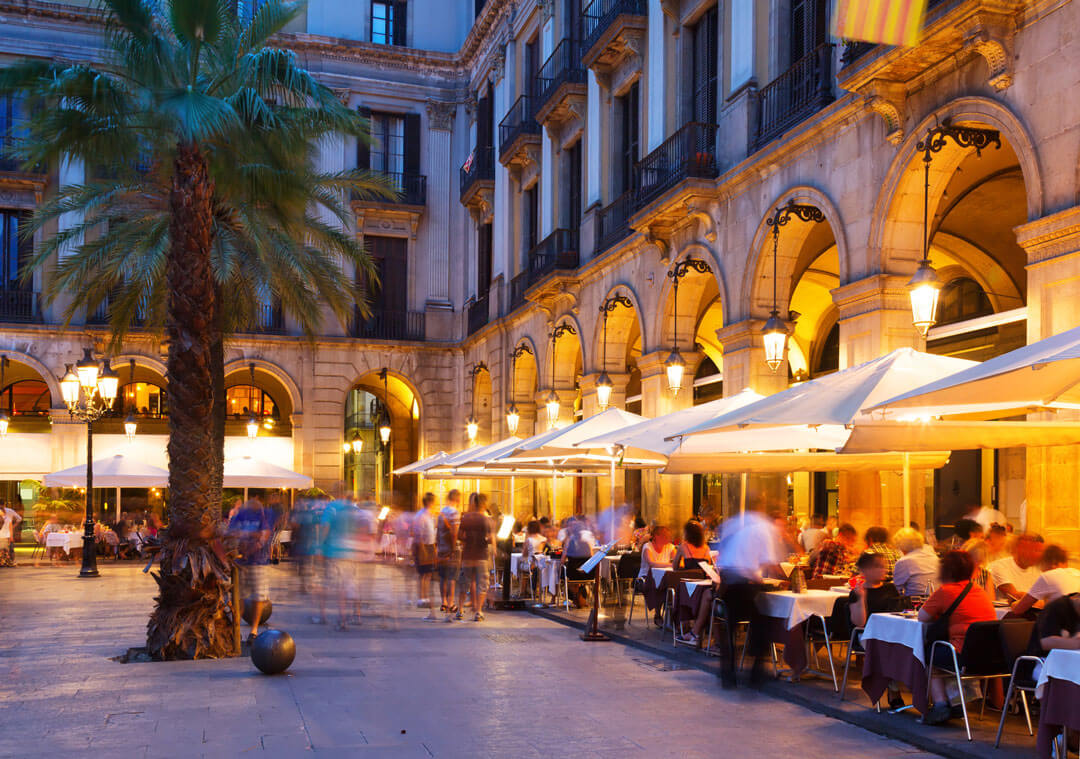 people dine alfresco in Barcelona plaza