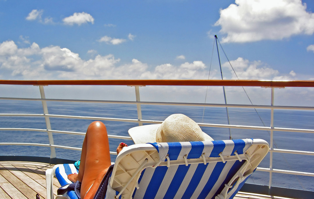 woman relaxes on cruise deck