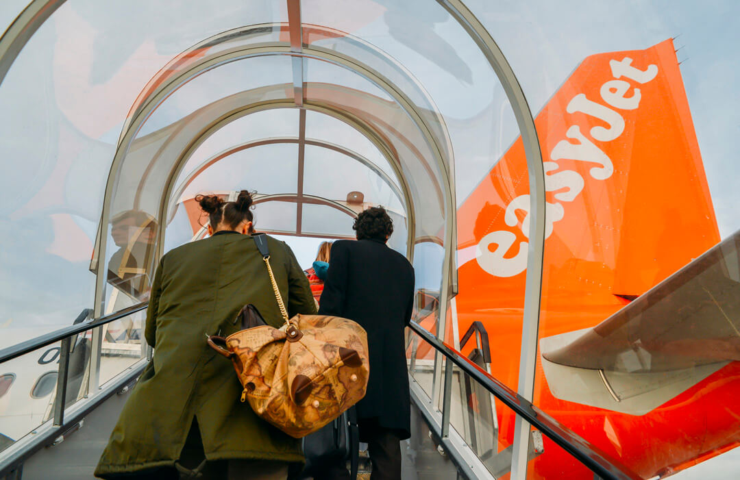 London Gatwick, March 15th, 2018: Passengers boarding an Airbus A320 easyJet airplane at London Gatwick's North Terminal